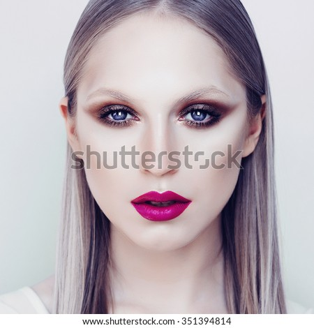 Portrait of beautiful girl close-up with bright makeup, the concept of beauty and winter - stock photo