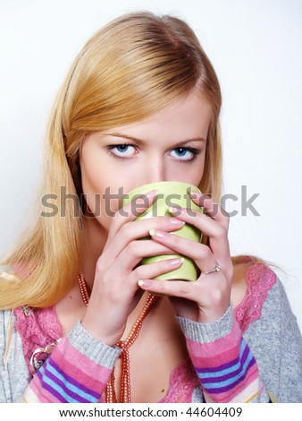 Portrait of beautiful girl drinking hot coffee or tea, isolated