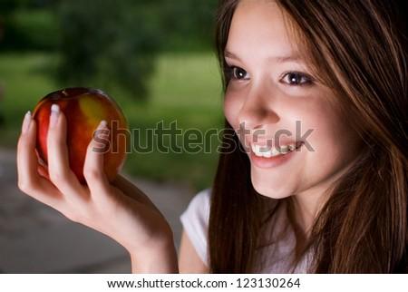 Portrait of beautiful girl eating apple - stock photo
