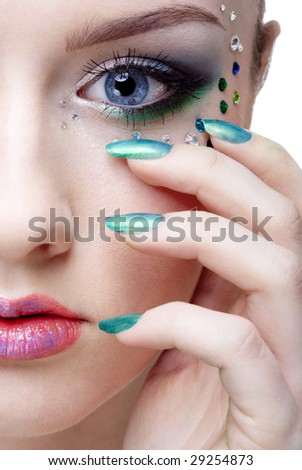 portrait of beautiful girl' half-face with mermaid bodyart