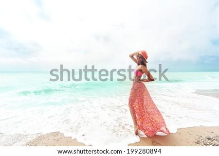 Portrait of beautiful girl having fun on the beach - stock photo