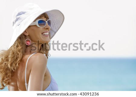 Portrait of beautiful girl having good time on tropical beach