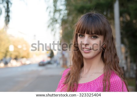Portrait of beautiful girl in a pink blouse