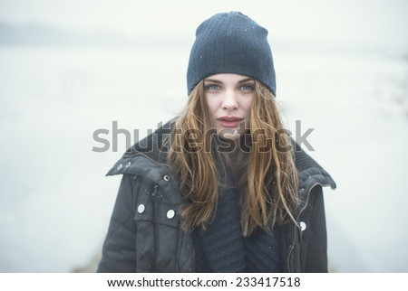 portrait of beautiful girl in cold tones - stock photo