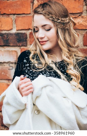 Portrait of beautiful girl in fashionable clothes