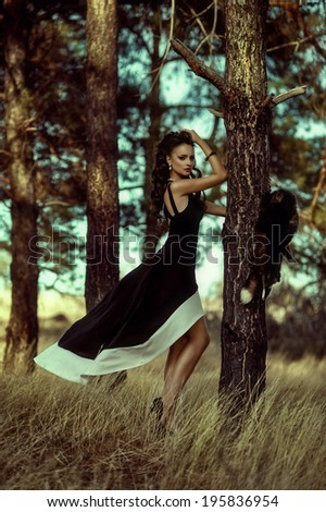 Portrait of beautiful girl in forest - stock photo