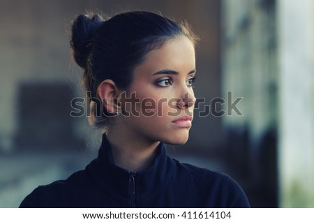 Portrait of beautiful girl in gym suit before fitness workout. - stock photo