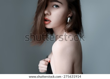 Portrait of beautiful girl in profile with red lips