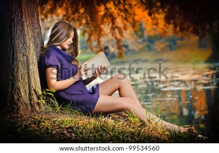 portrait of beautiful girl in the forest - stock photo
