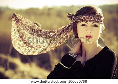 Portrait of beautiful girl in vintage style. Focus on face. - stock photo