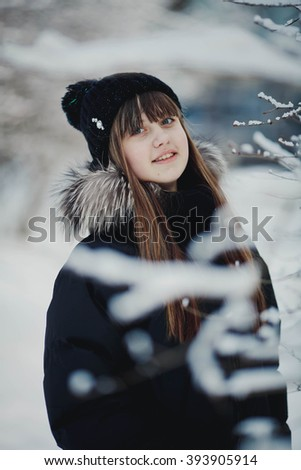 Portrait of beautiful girl in winter time