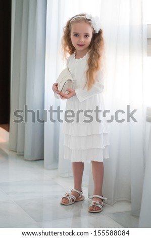 Portrait of beautiful girl near white curtain