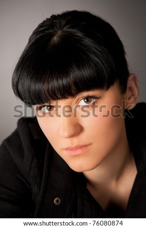 Portrait of beautiful girl on a grey background