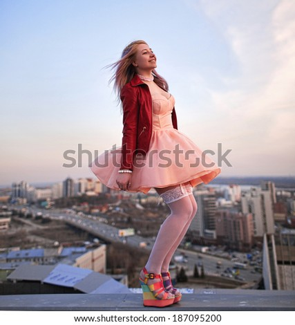 Portrait of beautiful girl on the roof - stock photo