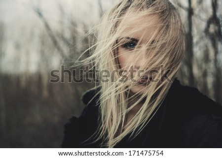 portrait of beautiful girl on windy day - stock photo