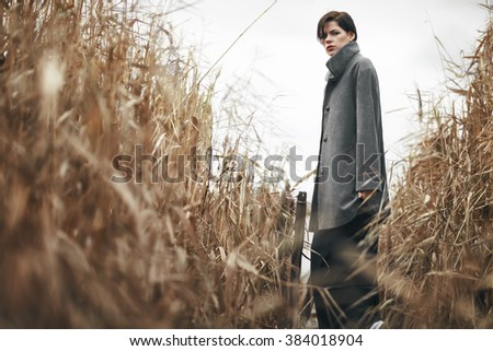 Portrait of beautiful girl outdoors in autumn - stock photo