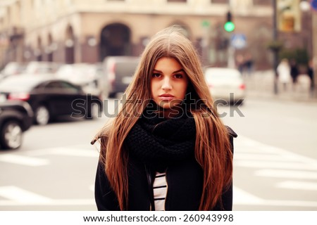Portrait of beautiful girl outdoors. Young hipster woman in the city traffic - stock photo