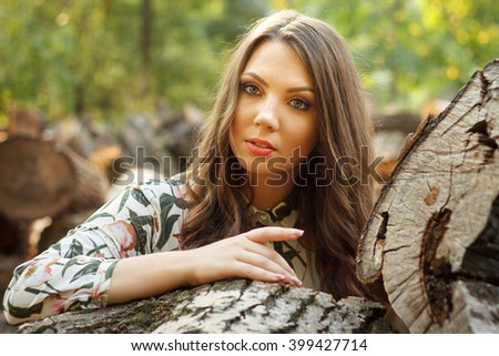 Portrait of beautiful girl poses on sanset outdoors