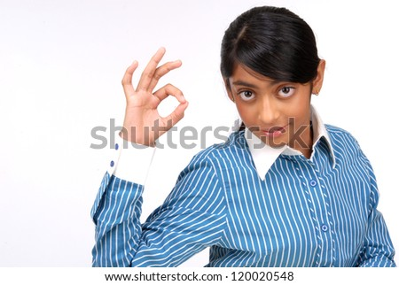 Portrait of beautiful girl showing OK sign and smiling, over white background - stock photo