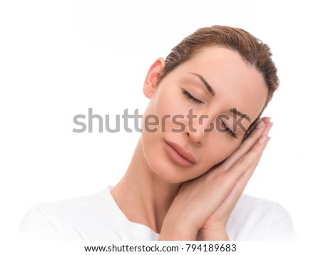 Portrait of beautiful girl sleeping on hands. Isolated on white background.