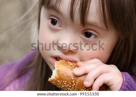 Portrait of beautiful girl that eating baguette - stock photo