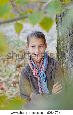 Portrait of beautiful girl walking in a autumn park