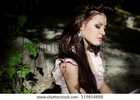 Portrait of beautiful girl walking in the park - stock photo
