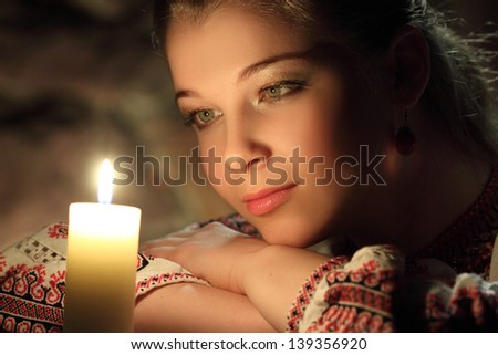 portrait of beautiful girl with a candle - stock photo