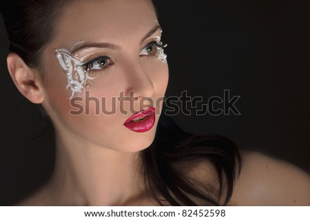 portrait of beautiful girl with art make up on black - stock photo