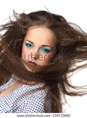 portrait of beautiful girl with art make-up on the wind - stock photo