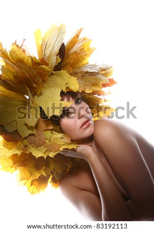 portrait of beautiful girl with autumn leaves