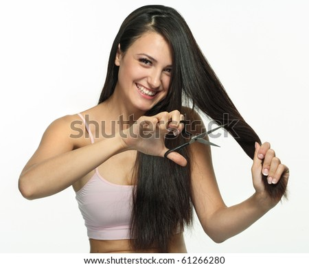 Portrait of beautiful girl with dark long hair.