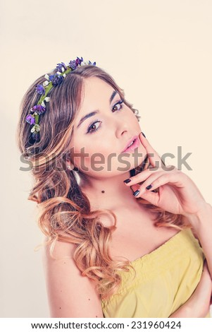 portrait of beautiful girl with flowers on her head - stock photo