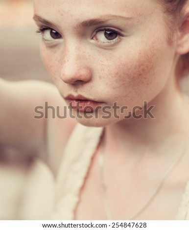 portrait of beautiful girl with freckles - stock photo