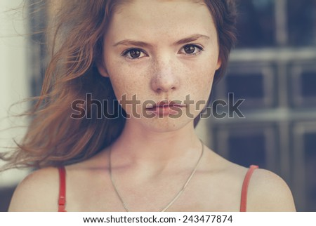 portrait of beautiful girl with freckles close-up - stock photo