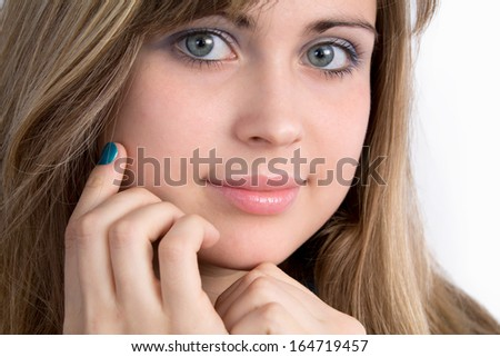 portrait of beautiful girl with hand near the cheeks
