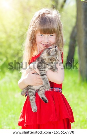Portrait of beautiful girl with kitten. Happy kids. Healthy lifestyle. Child care