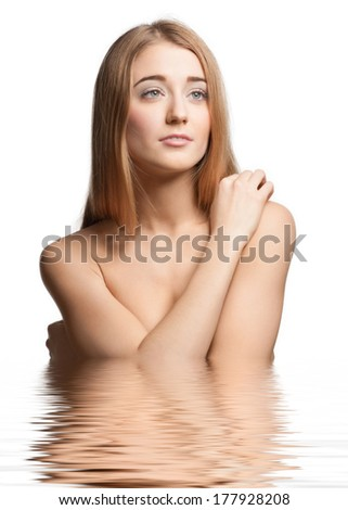 Portrait of beautiful girl with long blond hair in water. Beauty treatment concept  - stock photo