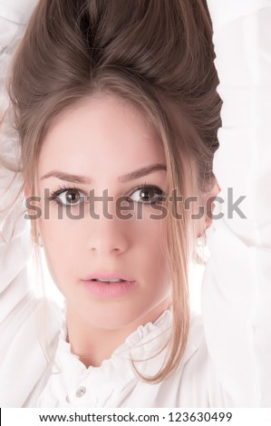 Portrait of beautiful girl with long hair
