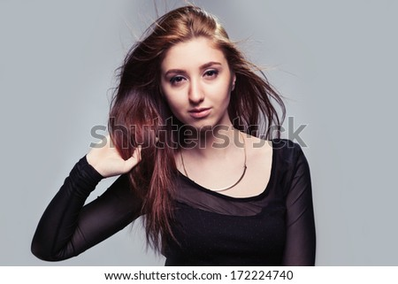 Portrait of beautiful girl with magnificent hair