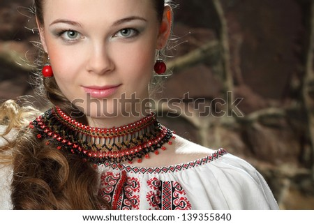 portrait of beautiful girl with necklaces - stock photo