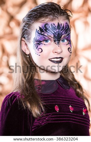 Portrait of beautiful girl with painted face - stock photo
