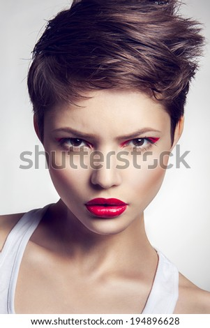 Portrait of beautiful girl with red lips. - stock photo