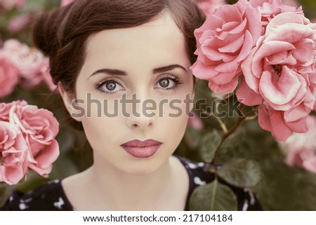 Portrait of beautiful girl with roses. - stock photo