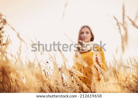 Portrait of beautiful girl with scarf in yellow autumn nature - stock photo