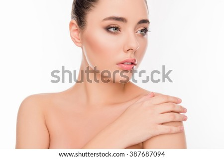Portrait of beautiful girl with sensual skin touching her shoulder - stock photo