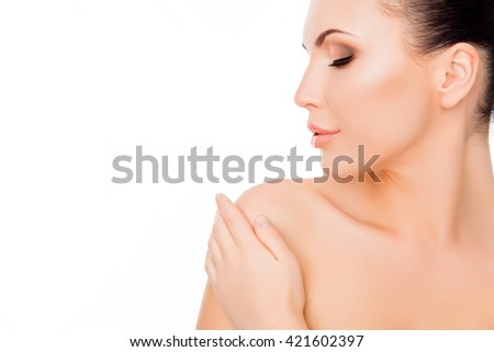 Portrait of beautiful girl with sensual skin touching her shoulder