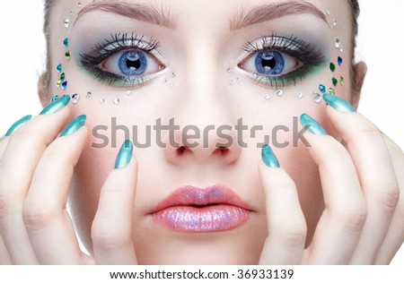 portrait of beautiful girl with strasses on the face - stock photo