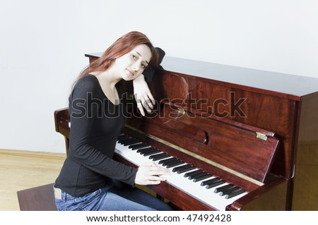 Portrait of beautiful girl with the piano