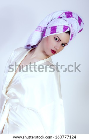 portrait of beautiful girl with towel on her head - stock photo